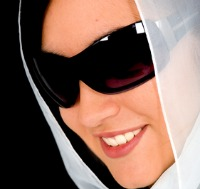 fashion woman wearing sunglasses wearing a veil over a black background