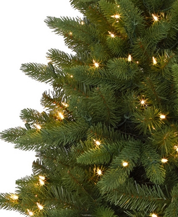 With an artificial but realistic Christmas tree as the centerpiece of your winter wonderland, you can add to it by bringing in tree branches, pine cones and wreathes.
