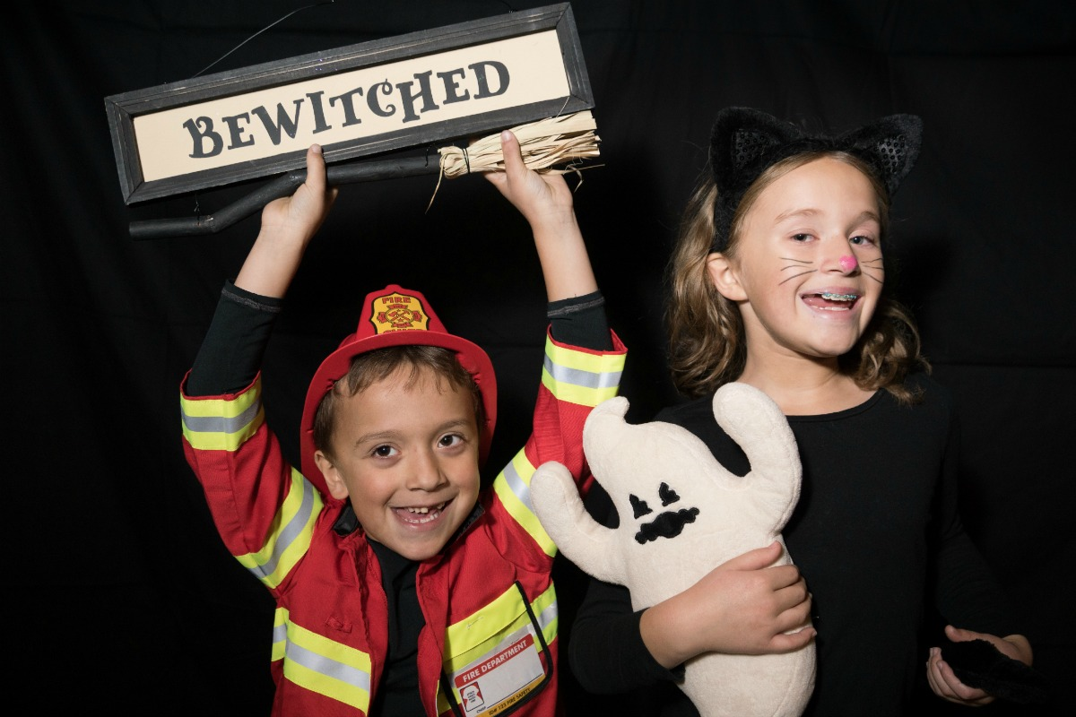 As kids get older, parents can get in on Halloween fun. We served sangria to trick-or-treater moms and dads, ate pizza, and set up a Halloween photo booth.