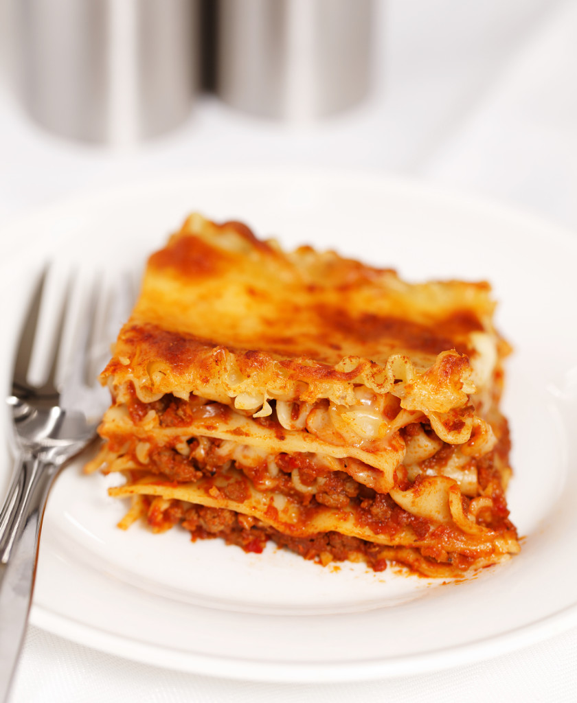fresh lasagna on white background
